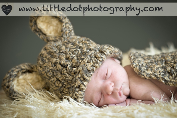 newborn in rabbit hat