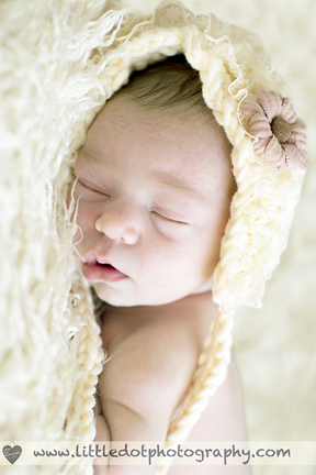newborn baby in bonnet