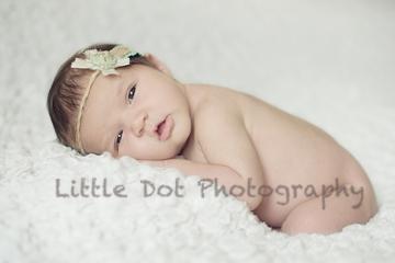 Newborn baby wearing headband