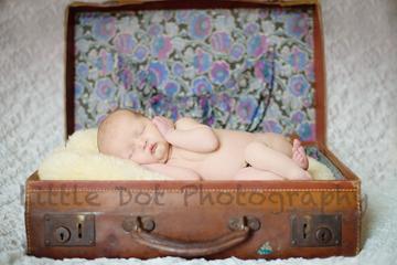 newborn in suitcase
