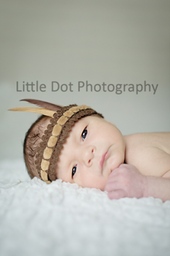 Newborn in Indian headband